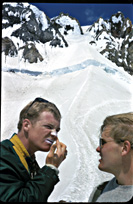two climbing partners applying zinc oxide on the Hogsback of Mt. Hood on the classic