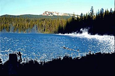 Maidu Lake above Miller Lake shows Tipsoo Peak, where the Pacific Crest Trail in Oregon reaches its highest point